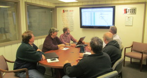 Group in conference room looking at screen