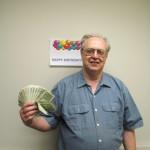 Employee Holding Birthday Cash Gift